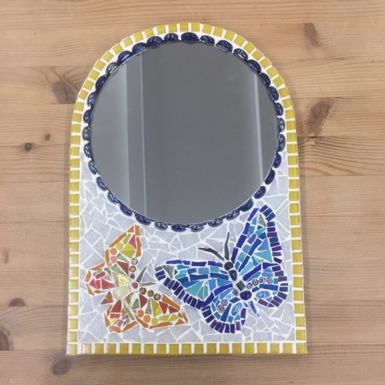 Round mirror decorated with mosaic