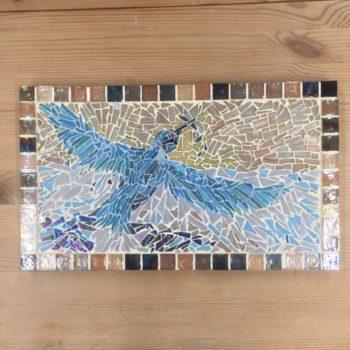 A mosaic featuring a kingfisher fishing
