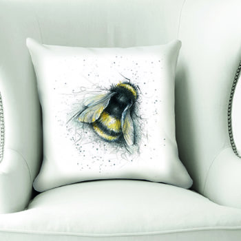 Bee Cushion by Beverley Fisher on a chair