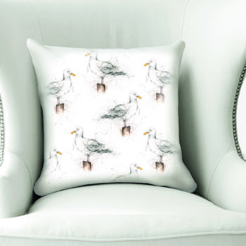 Seagulls Cushion by Beverley Fisher on a chair