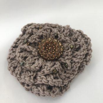 Mocha knitted brooch with gold embellishments by Christine Kolinsky