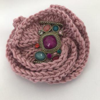 Dusky Pink knitted brooch with multi coloured embellishments by Christine Kolinsky