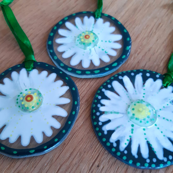 Sets of three glass hanging daisies by Christine Jeffryes