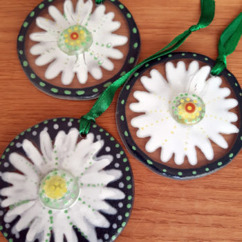 Trio of glass hanging daisies by Christine Jeffryes